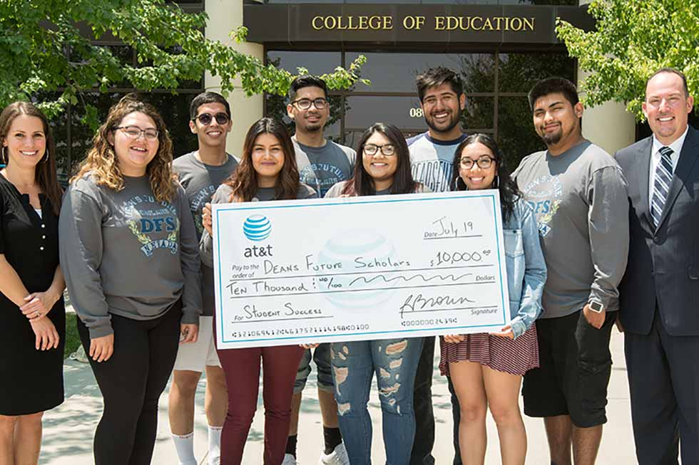 photo of students with ATT check